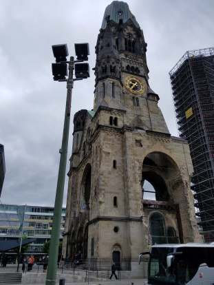 Wilhelm Memorial Church with bomb damage, purposefully left to show the next generation.